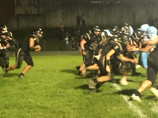 Seth Fitzgerald carries the ball up the middle for Buffalo Gap.