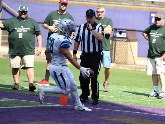 Lee High's Garrett Lawler scores a touchdown Saturday against Wilson Memorial at JMU during the Shenandoah Valley Football Classic.