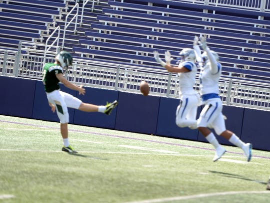 A pair of Lee High players block a Wilson Memorial punt Saturday during the Shenandoah Valley Football Classic at JMU.