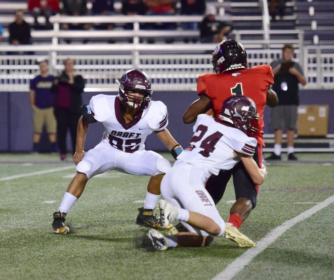 Stuarts Draft's Aaron Nice tacklers East Rockingham's J'wan Evans as teammate Jayden Watkins comes in for the assist during their Shenandoah District football game at the Shenandoah Valley Football Classic on Friday, Sept. 28, 2018 at James Madison University's Bridgeforth Stadium in Harrisonburg, Va.