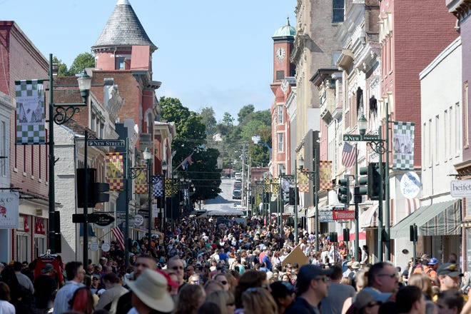 Festival-goers take part in the second day of the  Queen City Mischief & Magic in downtown Staunton, Va., Saturday, Sept. 28, 2018.