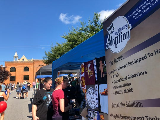 The Transfiguring Adoption booth during the Queen City Mischief & Magic festival on Sept. 29, 2018. The festival held in downtown Staunton took place Sept. 28-30.
