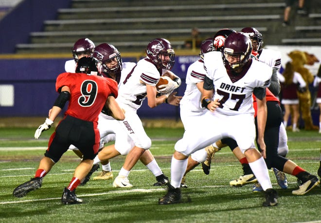 Stuarts Draft's Aaron Nice takes the handoff from quarterback Henry Cooke in the second quarter of the Cougars' Shenandoah Diastrict football game against East Rockingham at the Shenandoah Valley Football Classic on Friday, Sept. 28, 2018 at James Madison University's Bridgeforth Stadium in Harrisonburg, Va.