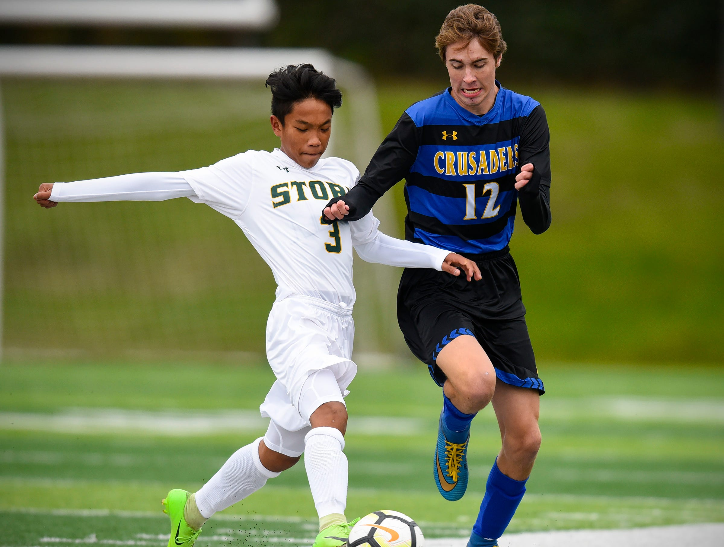 Sauk Rapids' Keegan Pham and Cathedral's Jackson Kent battle for the ball during the first half Saturday, Sept. 29, at Husky Stadium.