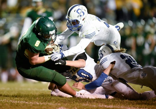 Sauk Rapids' JD Bates is brought down by the Sartell defense during the first half Friday, Sept. 28, in Sauk Rapids.