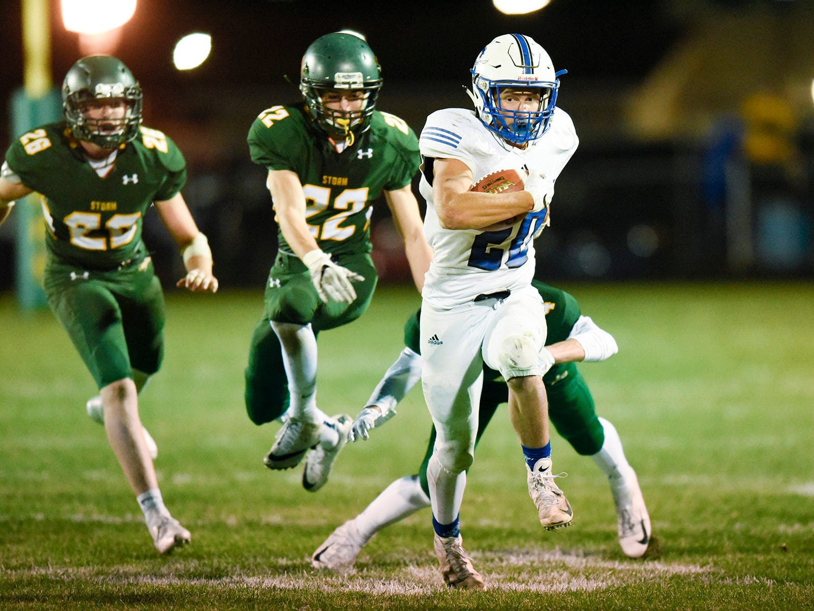 Sartell running back Cody Neitzke breaks away from the Sauk Rapids defense during the first half Friday, Sept. 28, in Sauk Rapids.