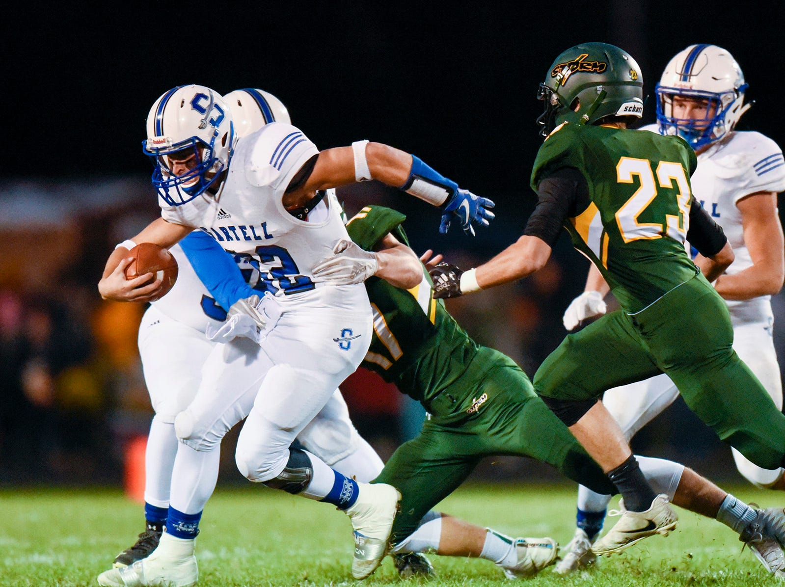 Sartell quarterback Ryan Giguere tries to break a tackle against Sauk Rapids during the first half Friday, Sept. 28, in Sauk Rapids.