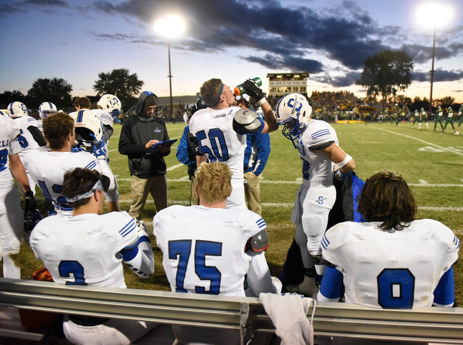 Sartell players on the sidelines during the first half Friday, Sept. 28, in Sauk Rapids.