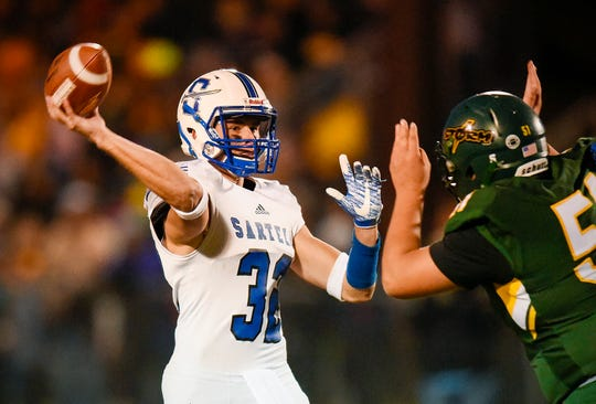 Sartell quarterback Ryan Giguere makes a pass during the first half Friday, Sept. 28, in Sauk Rapids.
