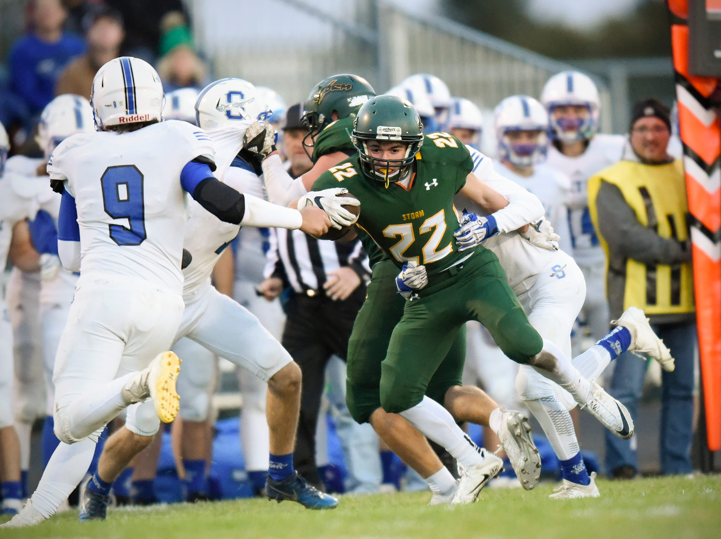 Sauk Rapids' Christian Rodriguez gains yards along the sideline before being brought down against Sartell during the first half Friday, Sept. 28, in Sauk Rapids.