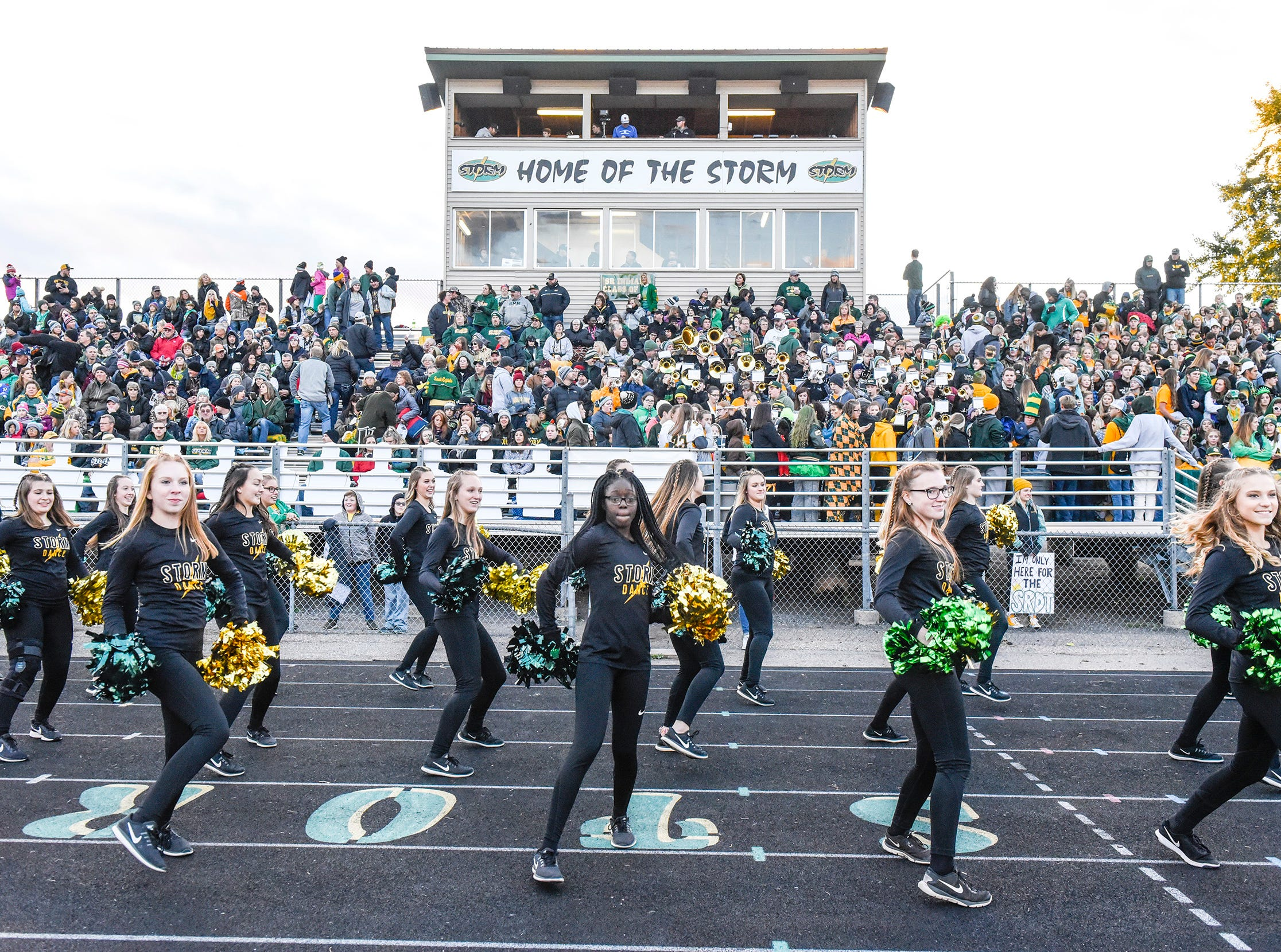 The Sauk Rapids pep band and cheerleaders entertains the fans before the start of the game.