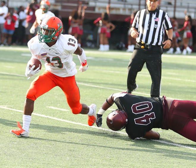 FAMU running back Bishop Bonnett dodges by North Carolina Central linebacker Patrick Conner.