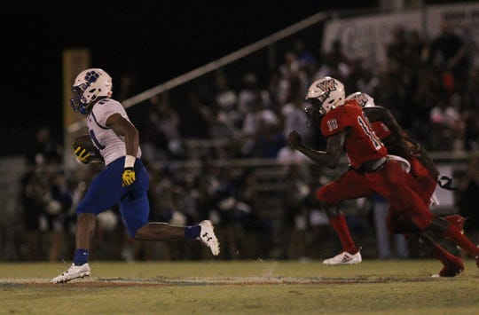 Godby receiver Trevor Solomon-Wilson hauls in an underthrown pass and takes off for an 82-yard touchdown catch as Godby beat Wakulla 37-13 on Friday night.