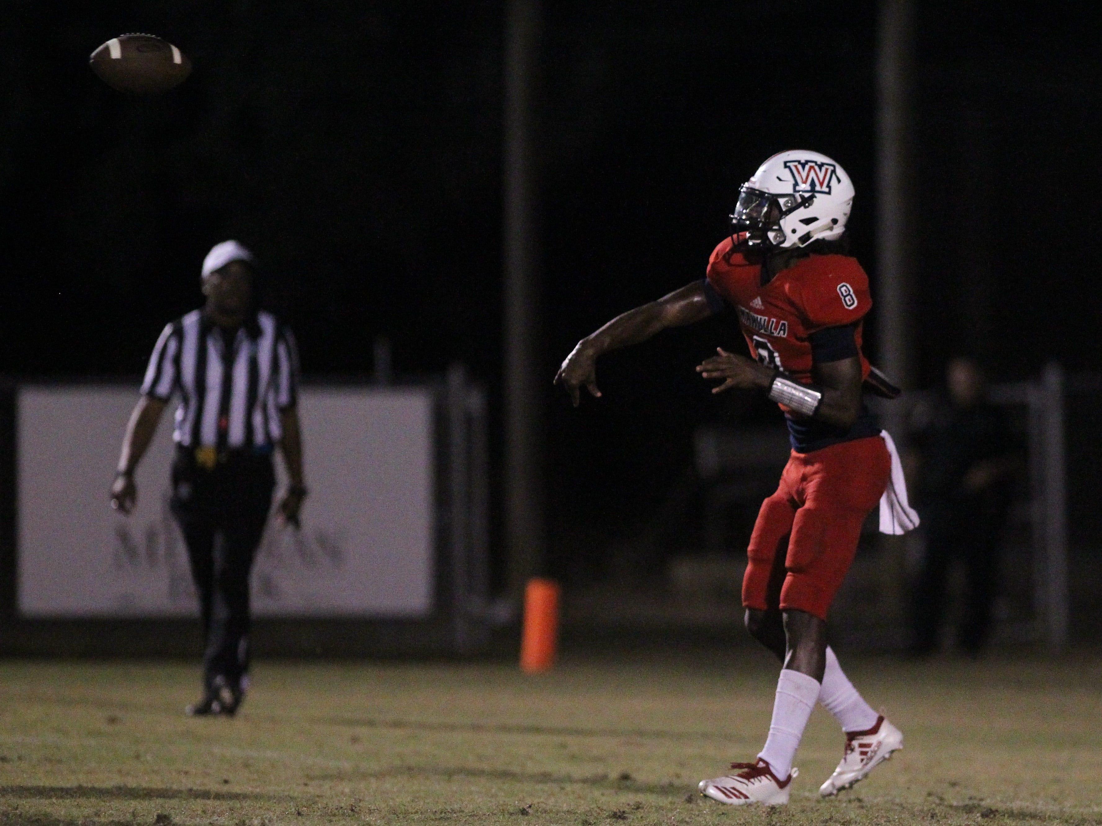 Wakulla quarterback Jaylon Worsham throws a pass as Godby beat Wakulla 37-13 on Friday night.