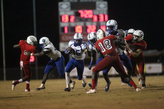 Godby running back Kamron Martin chews up hard yards on the ground as the Cougars beat Wakulla 37-13 on Friday night.