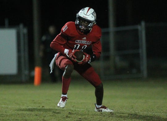 Wakulla's Malik Murray look upfield after recording a goal line interception. Murray also caught a 50-yard touchdown as Godby beat Wakulla 37-13 on Friday night.