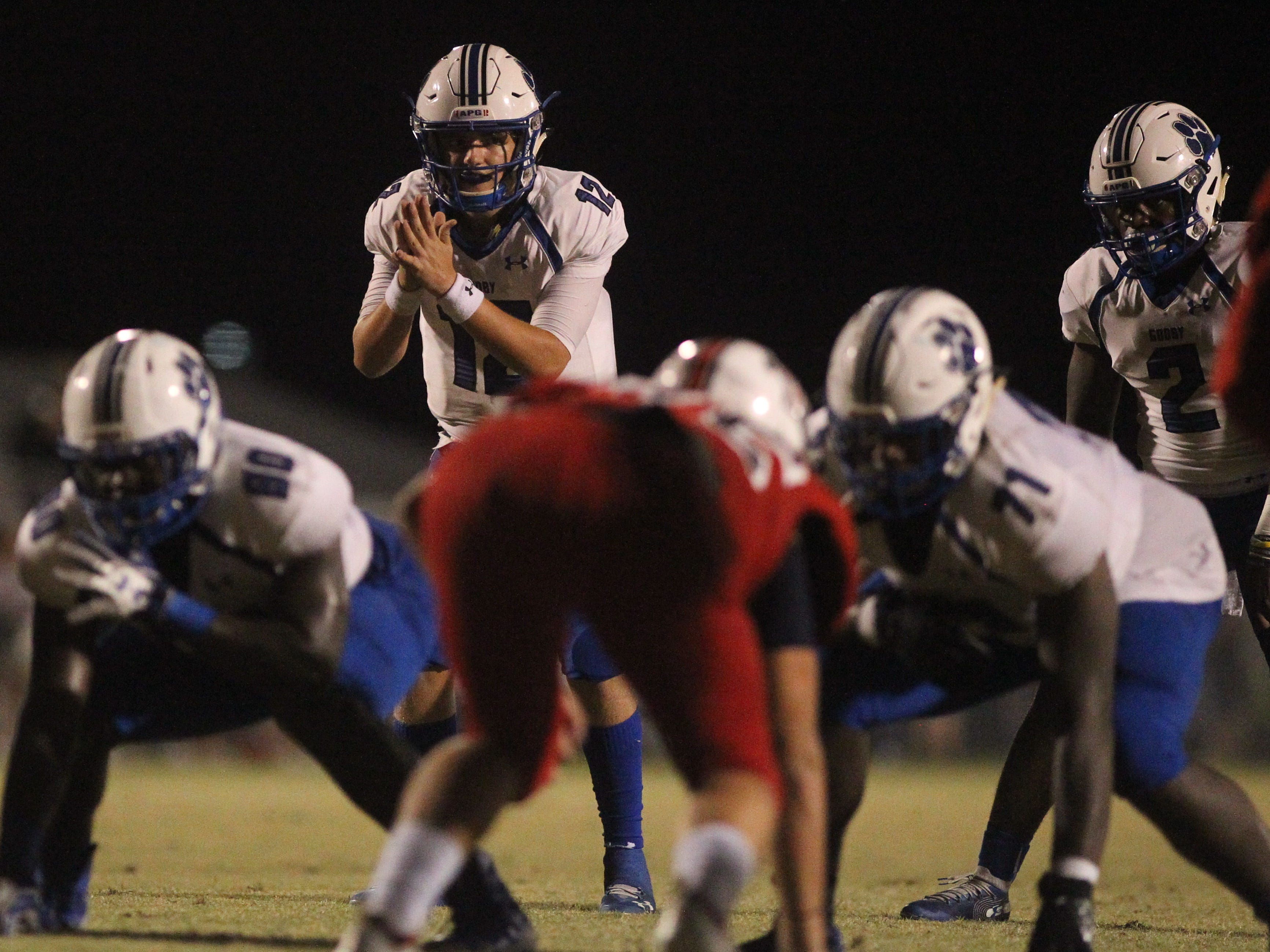 Godby quarterback Trey Fisher prepares for a snap as Godby beat Wakulla 37-13 on Friday night.