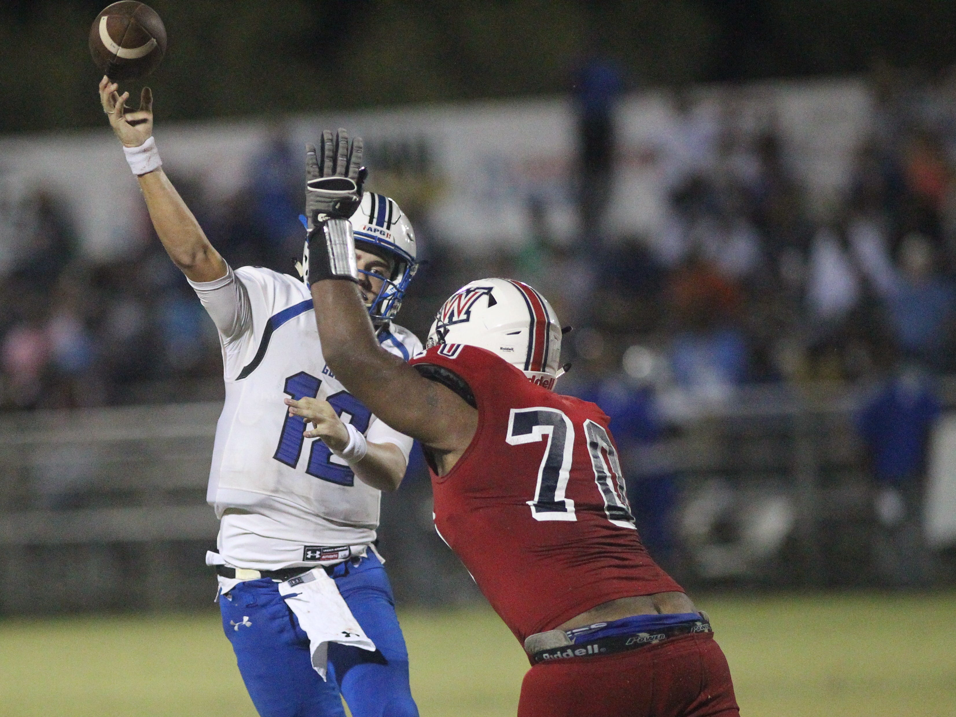 Godby quarterback Trey Fisher gets off a pass with a hand in his face as the Cougars beat Wakulla 37-13 on Friday night.