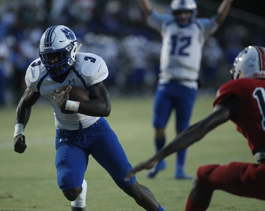 Godby running back Jaquez Yant runs for a 10-yard touchdown as Godby beat Wakulla 37-13 on Friday night.