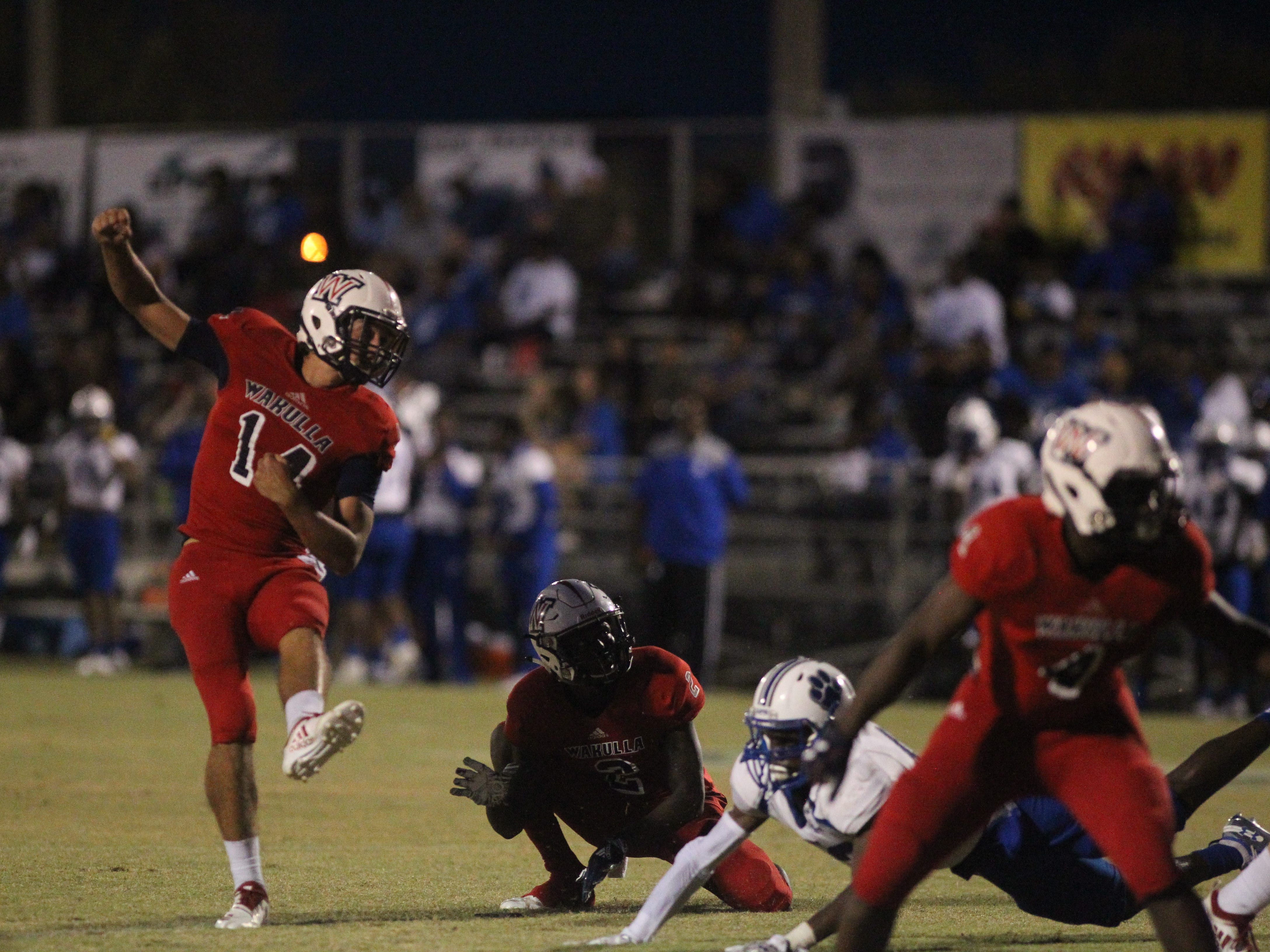 Wakulla's Hunter Busen watches a missed PAT Godby running back Jaquez Yant gains tough yards as Godby beat Wakulla 37-13 on Friday night.