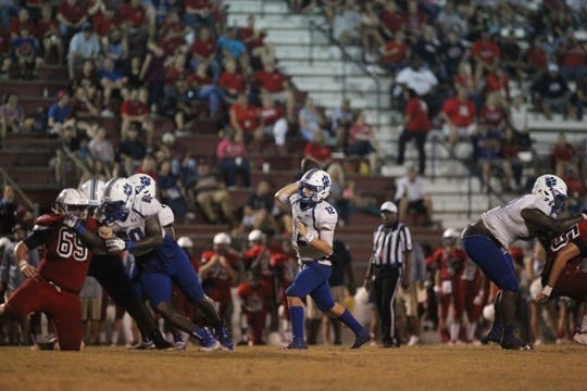 Godby quarterback Trey Fisher throws a pass as the Cougars beat Wakulla 37-13 on Friday night.