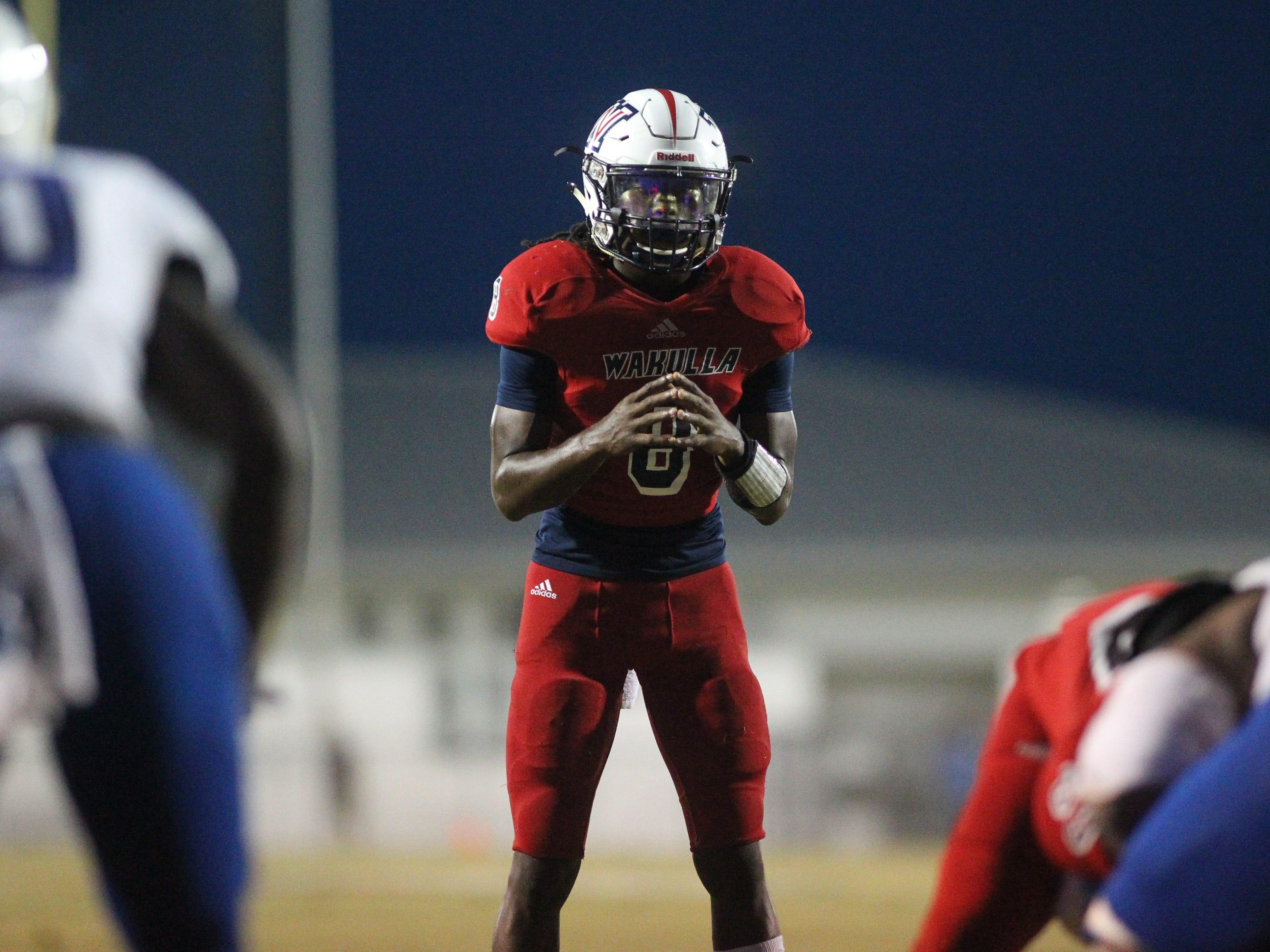 Wakulla quarterback Jaylon Worsham readies for a play as Godby beat Wakulla 37-13 on Friday night.