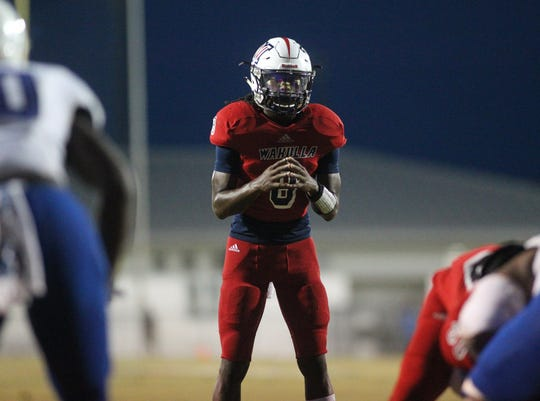 Wakulla quarterback Jaylon Worsham readies for a play as Godby beat Wakulla 37-13 on Friday night.