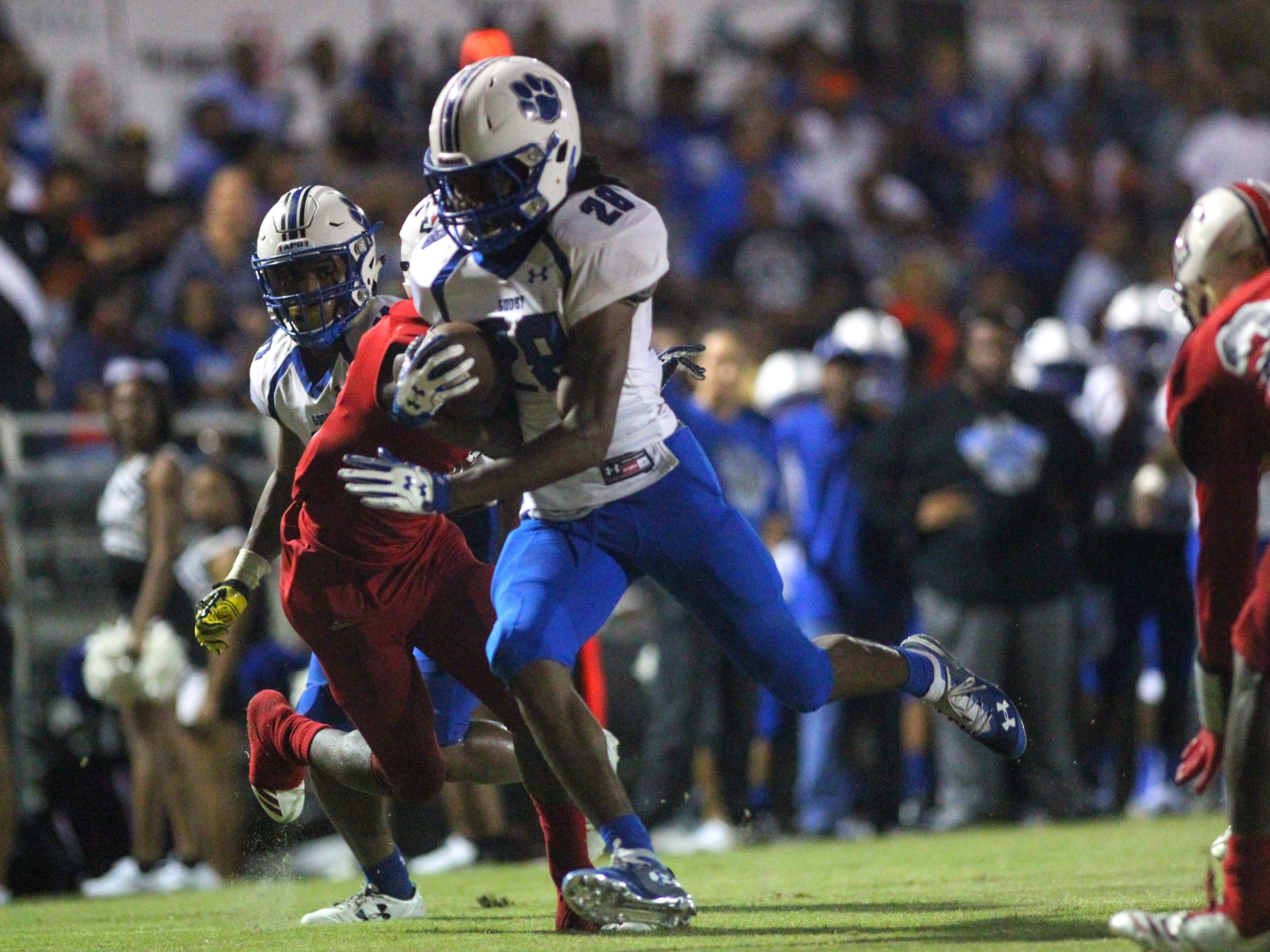Godby running back Tyrique Paramore runs for a touchdown as the Cougars beat Wakulla 37-13 on Friday night.