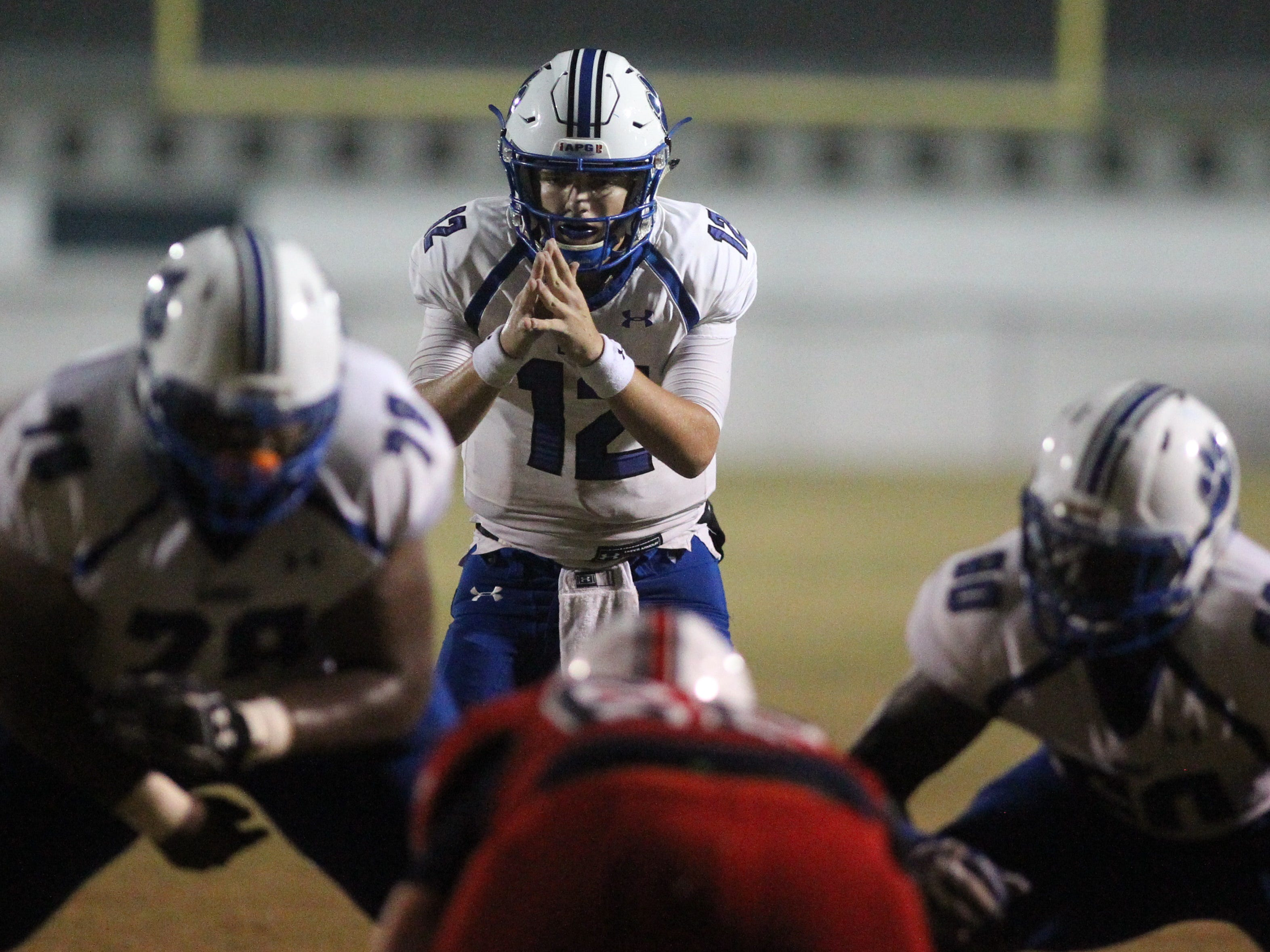 Godby quarterback Trey Fisher readies for a snap as Godby beat Wakulla 37-13 on Friday night.