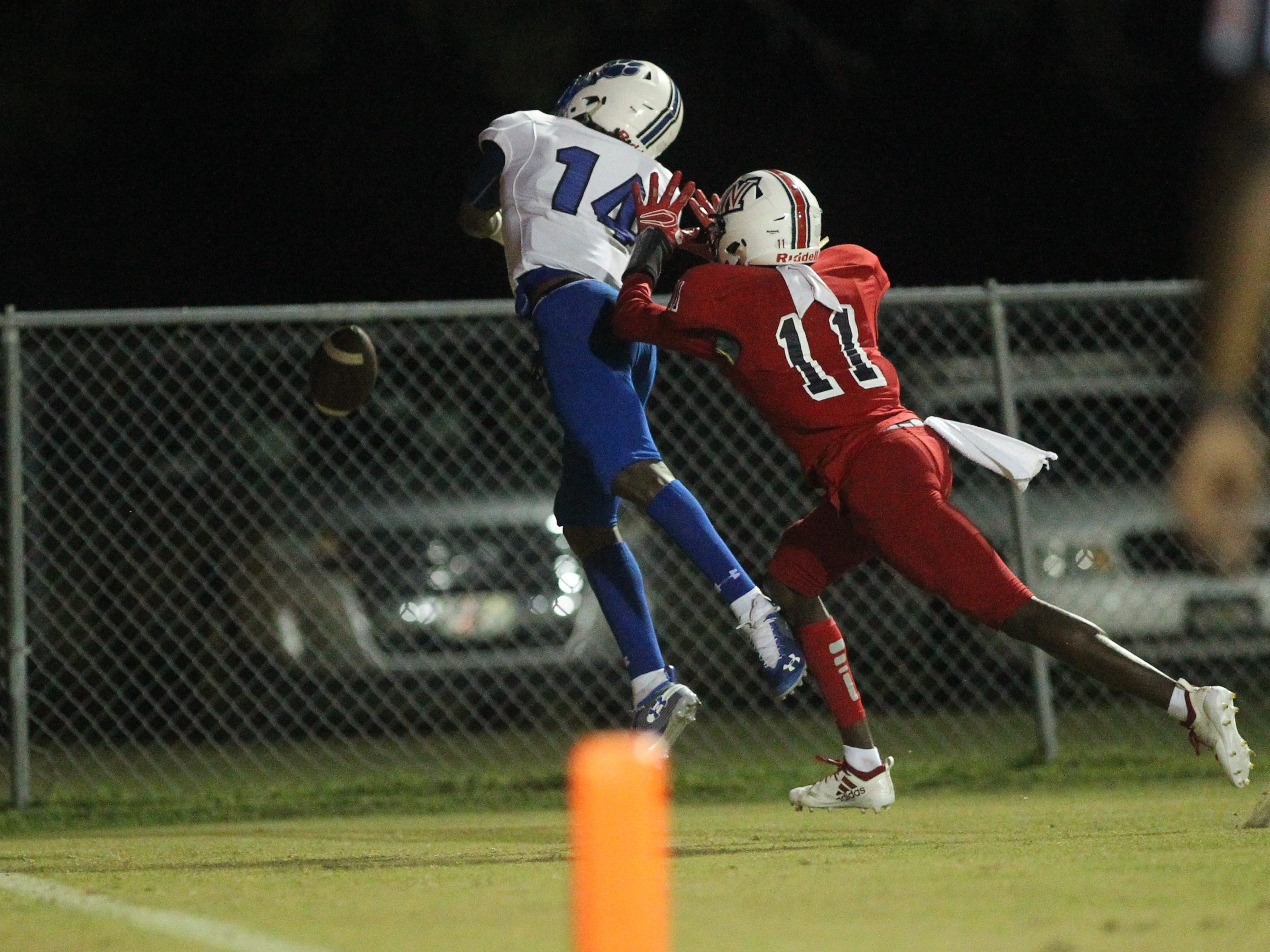 Wakulla's Malik Murray pushes Godby receiver Ja'heim Knight on a ball just out of Knight's reach as Godby beat Wakulla 37-13 on Friday night.