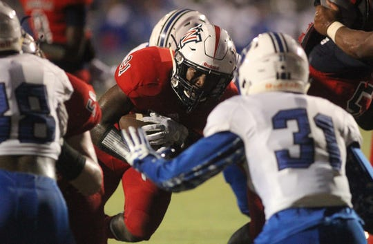 Wakulla running back Lamonta Peterson carries in for a 1-yard touchdown as Godby beat Wakulla 37-13 on Friday night.