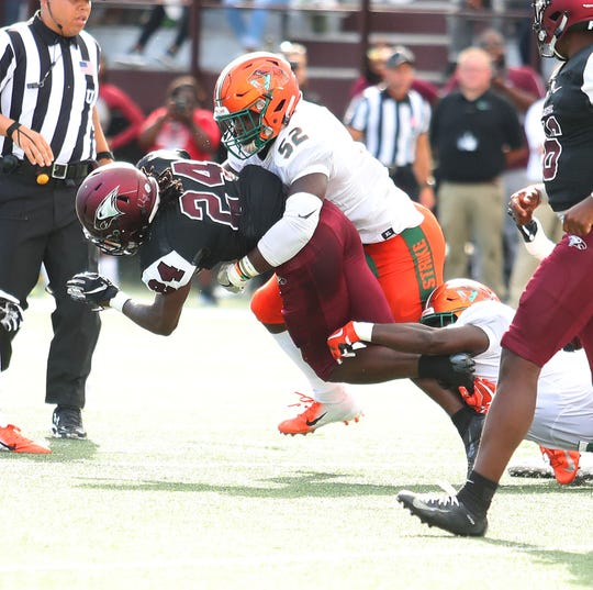 FAMU linebacker Derrick Mayweather tackles North Carolina Central running back Tyquan Watson.
