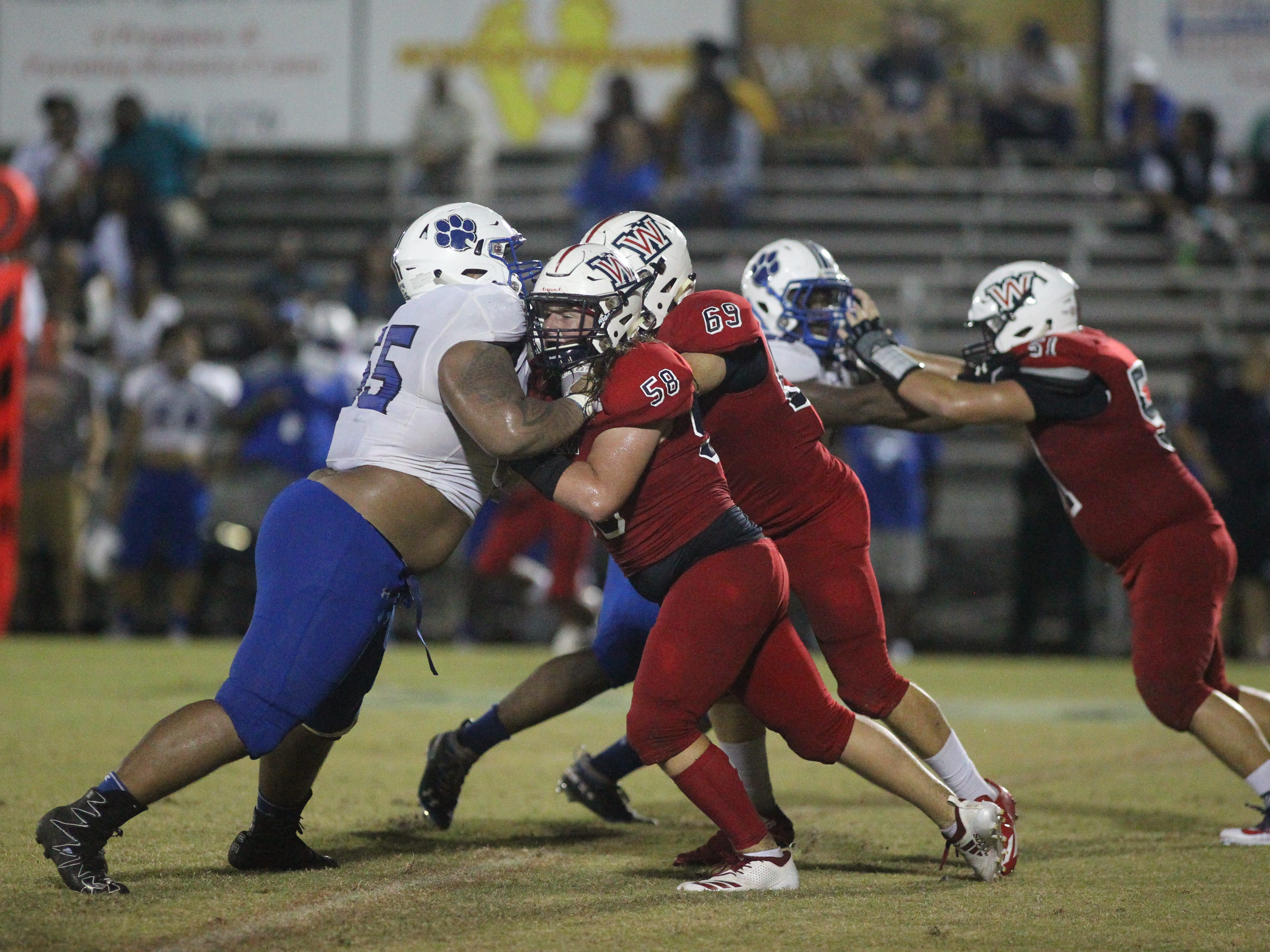 Godby defensive lineman Quentin Jones takes on two Wakulla offensive linemen as the Cougars beat Wakulla 37-13 on Friday night.