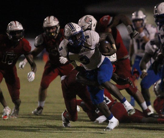 Godby running back Jaquez Yant picks up hard yards as the Cougars beat Wakulla 37-13 on Friday night.
