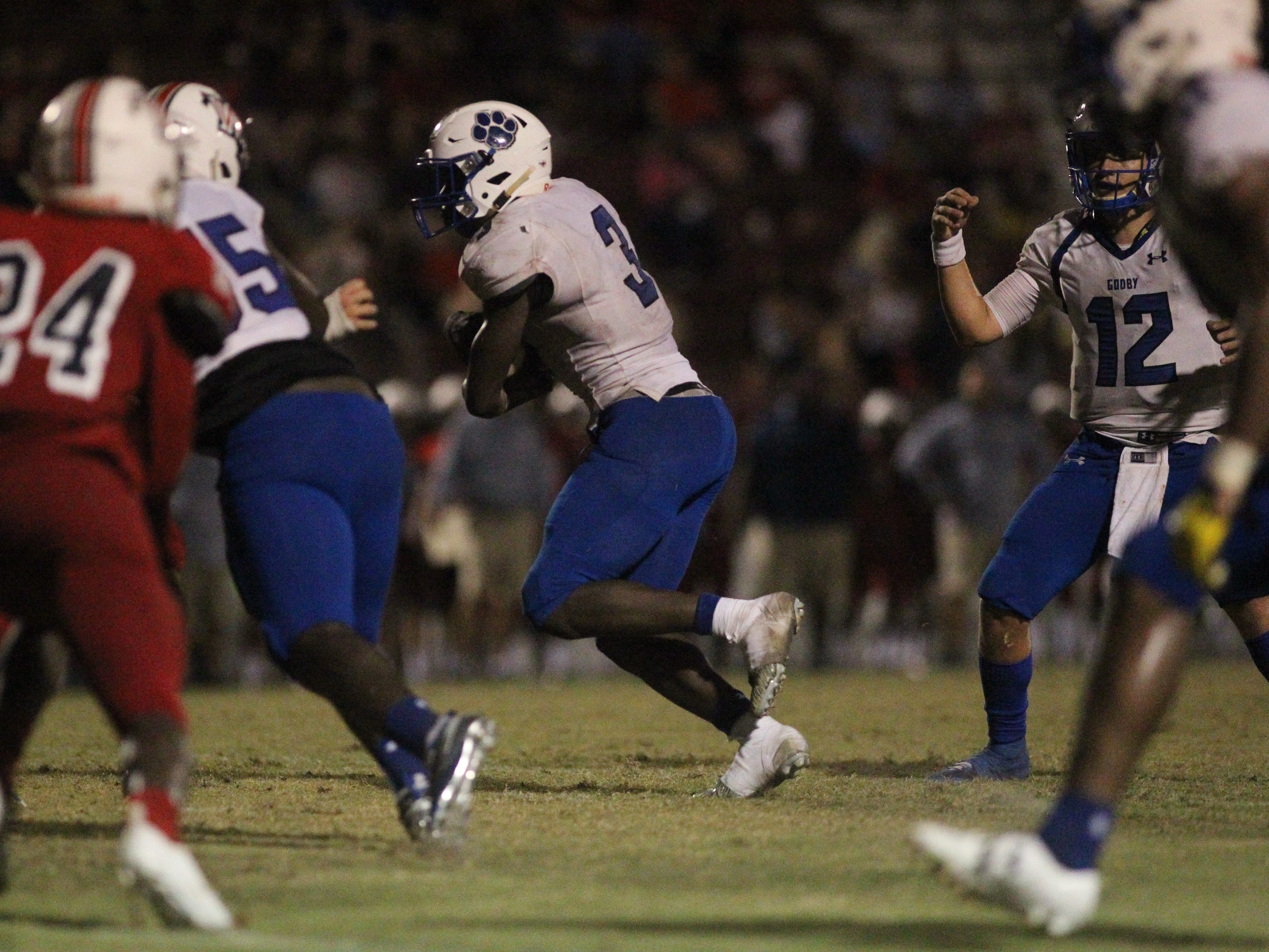Godby running back Jaquez Yant looks for running room as the Cougars beat Wakulla 37-13 on Friday night.