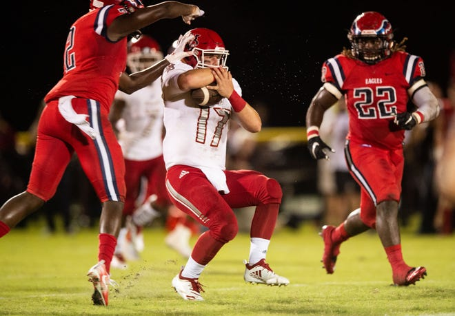 Vero Beach quarterback Nick Celidonio runs under pressure for a big gain in the second quarter against St. Lucie West Centennial during the high school football game Friday, Sept. 28, 2018, at South County Stadium in Port St. Lucie.