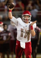 Vero Beach quarterback Nick Celidonio completes a pass in the second quarter against St. Lucie West Centennial during the high school football game Friday, Sept. 28, 2018, at South County Stadium in Port St. Lucie.