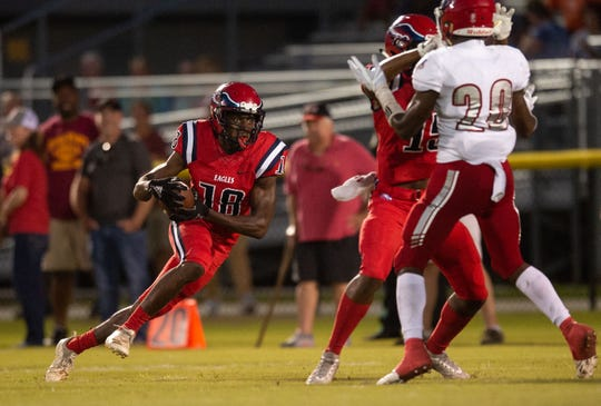 St. Lucie West Centennial's Datwan Blackwood runs for yards on a reception in the first half against Vero Beach during the high school football game Friday, Sept. 28, 2018, at South County Stadium in Port St. Lucie.