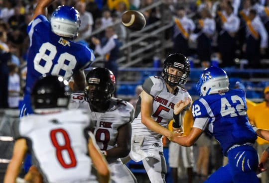 South Fork quarterback Ryan Gross launches the ball to teammate Jonah Morse (8) Friday, Sept. 28, 2018, during the annual Martin Bowl high school football game against Martin County at Martin County High School.