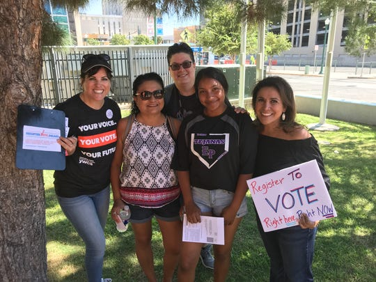 YWCA staff were excited to see Kristina Mendez, second from right, register to vote. She just turned 18 and was at the event with her mother and cousin.