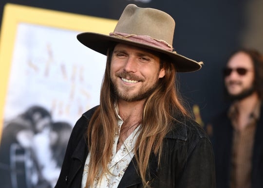 """Lukas Nelson arrives at the Los Angeles premiere of """"A Star Is Born"""" on Monday, Sept. 24, 2018, at the Shrine Auditorium."""