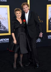 """Lorna Luft, left, and Barry Manilow arrive at the Los Angeles premiere of """"A Star Is Born"""" on Monday, Sept. 24, 2018, at the Shrine Auditorium."""