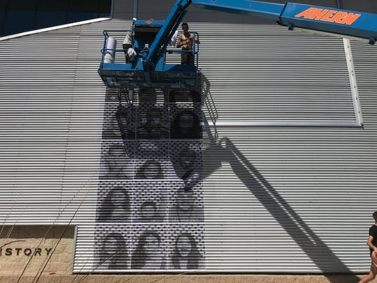 A crew begin creating the selfie mural on Saturday outside the El Paso Museum of History.