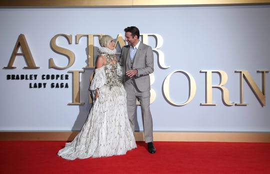 """Actress and singer Lady Gaga, left, and actor and director Bradley Cooper pose for photographers upon arrival at the premiere of the film """"A Star Is Born"""" in London, Thursday, Sept. 27, 2018."""