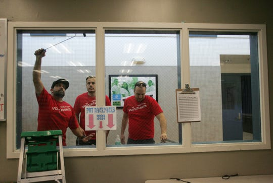 From left, Shawn Kamrava, Jamil Schanti  and Mike Zajac paint the trim of the windows as volunteers from local Wells Fargo Banks help beautify the Boys & Girls Club of Simi Valley on Saturday as part of the 29th annual United Way of Ventura County Day of Caring.