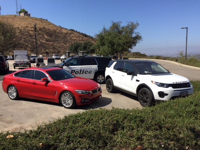 A Land Rover and a BMW seized by Thousand Oaks police in an identity theft case.