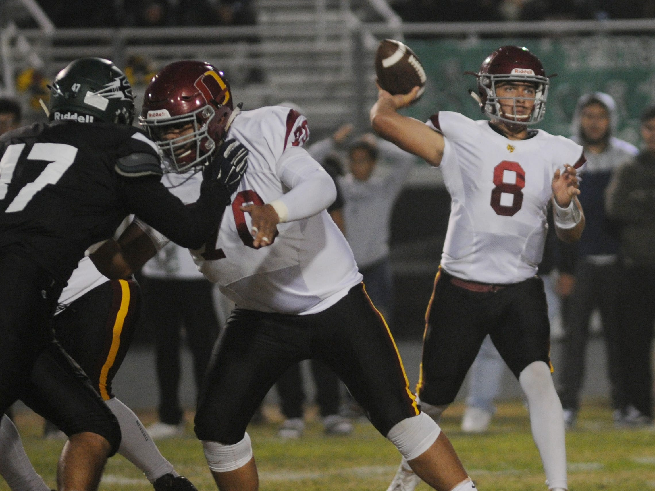 Oxnard quarterback Vincent Walea throws a pass during the Yellowjackets' 24-14 win at Pacifica on Friday night.