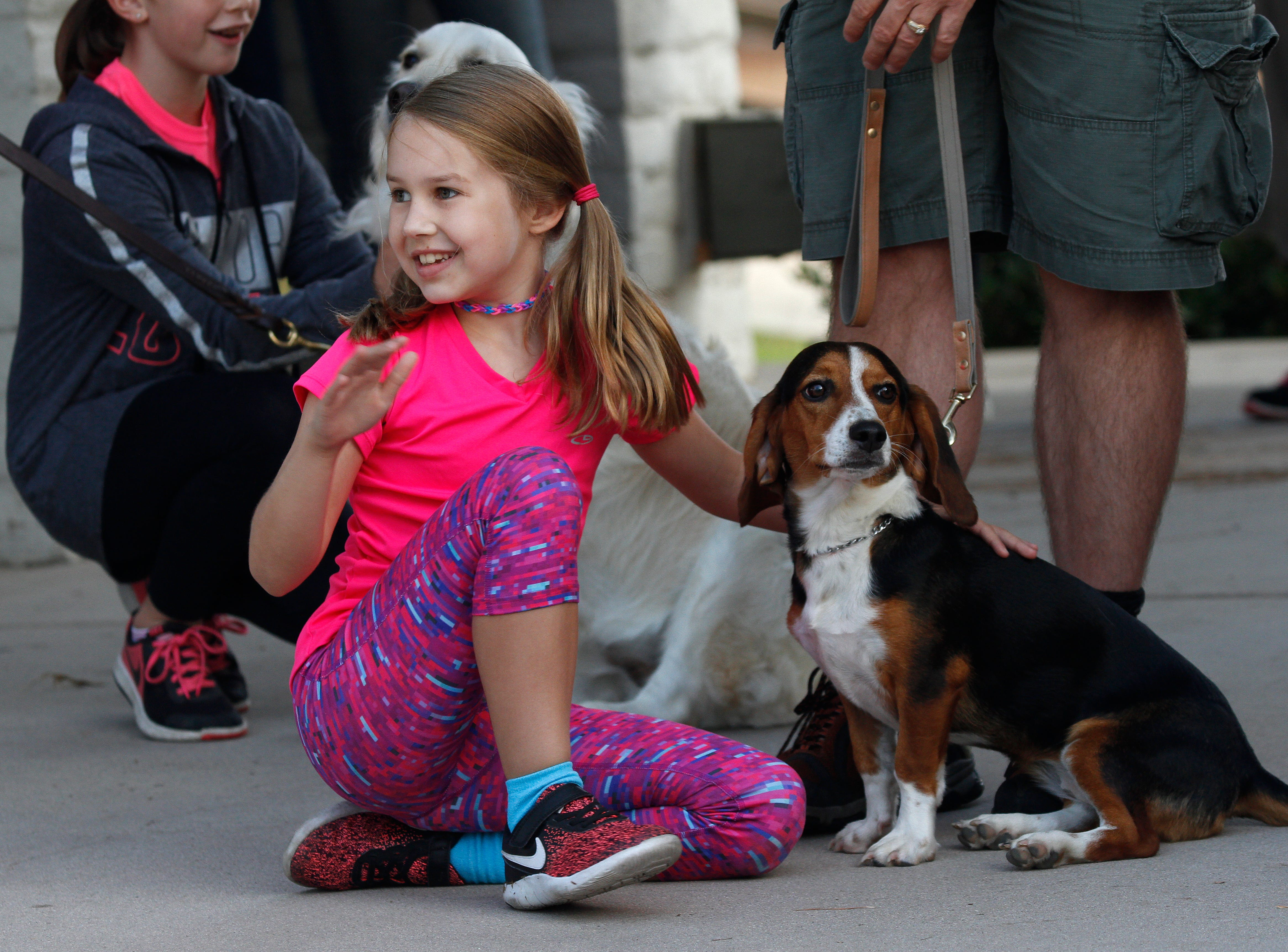 Morgan Dooley, 8, sits with her beagle Shasta as she awaits her dog's turn to perform a trick on stage Saturday during the 13th annual Family Fun Wag 'n' Walk, a fundraiser for Animal Rescue Volunteers in Simi Valley.