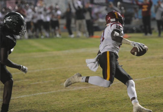 Oxnard's Xavier Harris scores a touchdown during Friday night's 24-14 win over host Pacifica.
