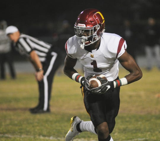 """Despite being a top player for Oxnard High's basketball team and already committed to play football at Oregon, J.R. Waters will play in Saturday's Ventura County All-Star Football Game. """"I want to go all out and give my full effort,"""" Waters said."""